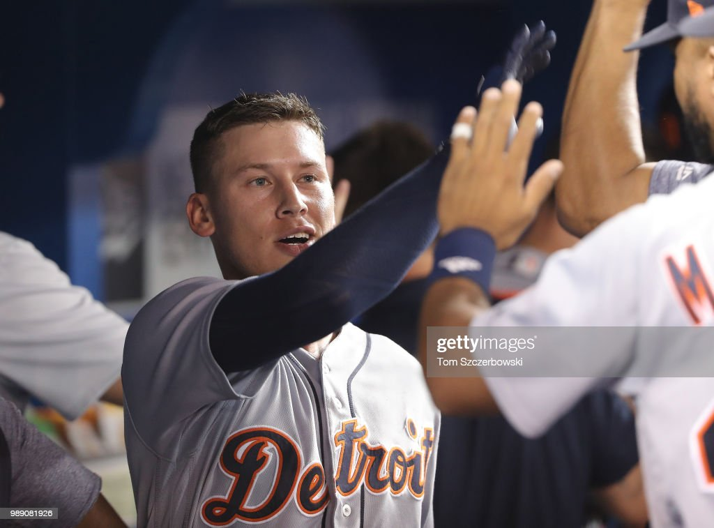 JaCoby Jones #21 of the Detroit Tigers is congratulated by teammates in the dugout after hitting a two-run home run in the ninth inning during MLB game action against the Toronto Blue Jays at Rogers Centre on July 1, 2018 in Toronto, Canada.