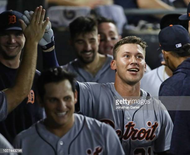 JaCoby Jones of the Detroit Tigers is congratulated ib the dugout after hitting a solo home run in the 4th inning against the Chicago White Sox at...