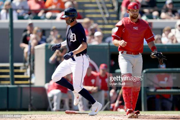 JaCoby Jones of the Detroit Tigers scores a run past Drew Butera of the Philadelphia Phillies in the third inning during the Grapefruit League spring...