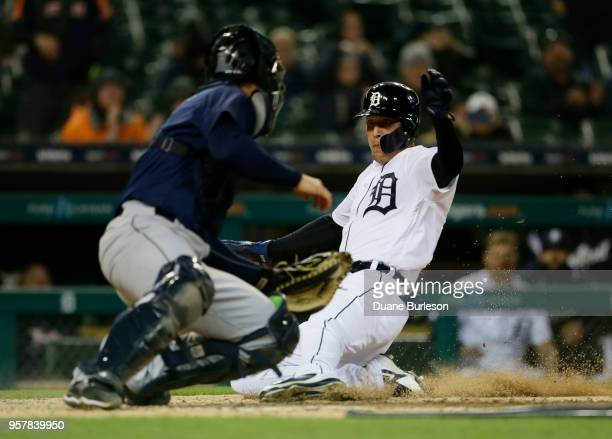 JaCoby Jones of the Detroit Tigers scores from first base against catcher David Freitas of the Seattle Mariners on a double by Pete Kozma of the...