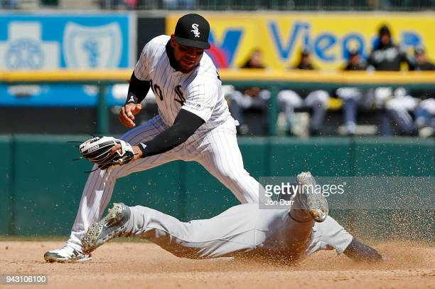 JaCoby Jones of the Detroit Tigers steals second base as Yoan Moncada of the Chicago White Sox is late on the tag during the fourth inning at...