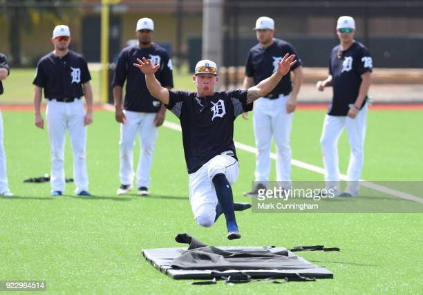 JaCoby Jones of the Detroit Tigers works on a sliding drill during Spring Training workouts at the TigerTown Facility on February 21 2018 in Lakeland...