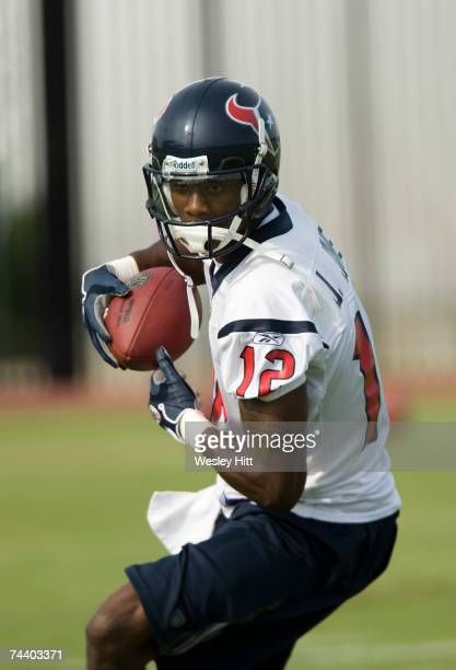 Jacoby Jones of the Houston Texans turns to run after catching a pass during OTA camp at the Texans Methodist Training Center on June 5, 2007 in...