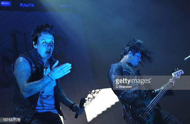 Jacoby Shaddix and Tobin Esperance of Papa Roach perform on stage during the 'Rockstar Taste Of Chaos' concert at Wembley Arena on December 8 2010 in...