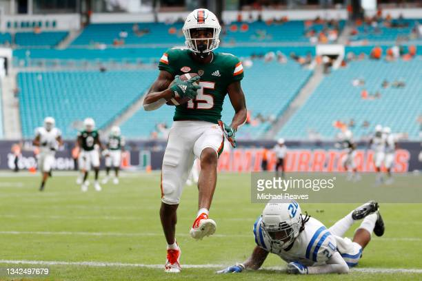 Jacolby George of the Miami Hurricanes runs into the endzone for a 44-yard touchdown reception against the Central Connecticut State Blue Devils...