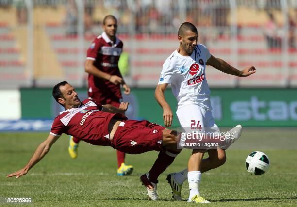 Jacopo Dall'Oglio of Reggina competes for the ball with Daniele Martinelli of Trapani during the Serie B match between Trapani Calcio and Reggina...