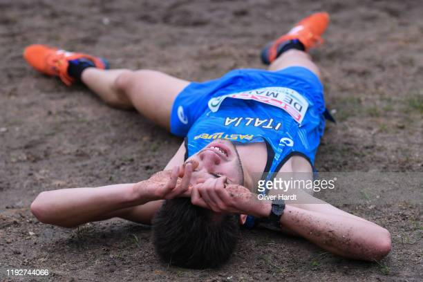 Jacopo de Marchi of Italy lies on the ground after his finished the U23 Men's race of the SPAR European Cross Country Championships at the Parque da...