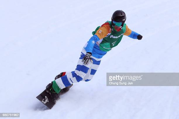 Jacopo Luchini of Italy competes in the Snowboard Men's Snowboard Cross SBUL Small Final during day three of the PyeongChang 2018 Paralympic Games on...
