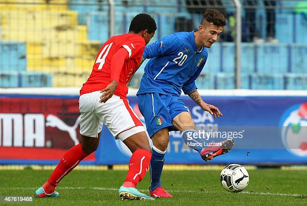 Jacopo Manconi of Italy competes for the ball with Manuel Akanji of Switzerland during the 4 Nations Tournament match between Italy U20 and...