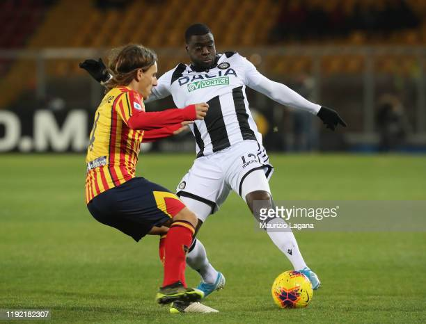 Jacopo Petriccione of Lecce competes for the ball with Ken Sema of Udinese during the Serie A match between US Lecce and Udinese Calcio at Stadio Via...