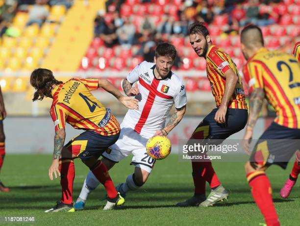 Jacopo Petriccione of Lecce competes for the ball with Lasse Schone of Genoa during the Serie A match between US Lecce and Genoa CFC at Stadio Via...