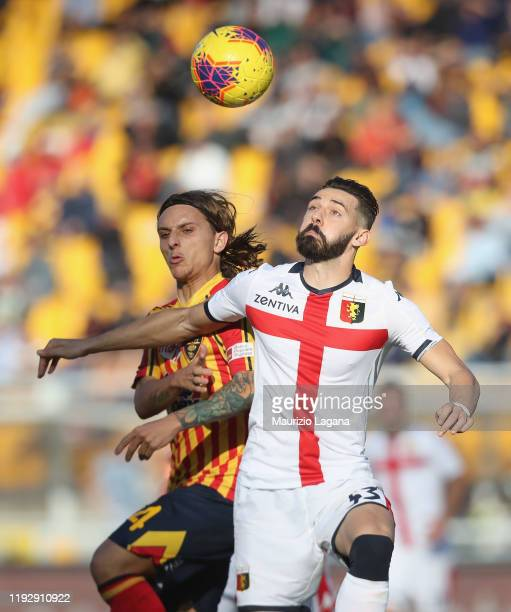 Jacopo Petriccione of Lecce competes for the ball with Marko Pajac of Genoa during the Serie A match between US Lecce and Genoa CFC at Stadio Via del...