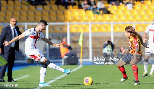 Jacopo Petriccione of Lecce competes for the ball with Paolo Ghiglione of Genoa during the Serie A match between US Lecce and Genoa CFC at Stadio Via...