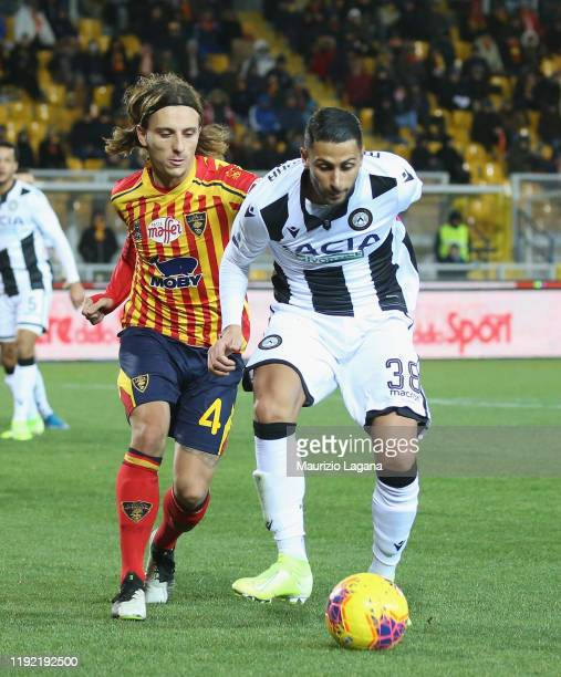 Jacopo Petriccione of Lecce competes for the ball with Rolando Mandragora of Udinese during the Serie A match between US Lecce and Udinese Calcio at...
