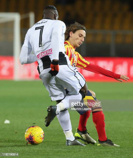 Jacopo Petriccione of Lecce competes for the ball with Seko Fofana of Udinese during the Serie A match between US Lecce and Udinese Calcio at Stadio...