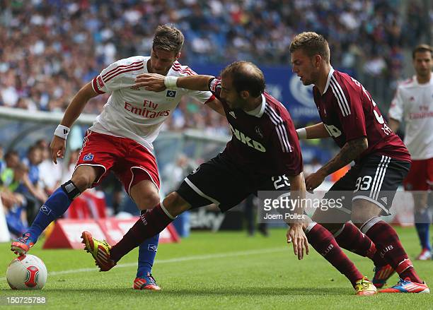 Jacopo Sala of Hamburg and Javier Pinola of Nuernberg compete for the ball during the Bundesliga match between Hamburger SV and 1 FC Nuernberg at...