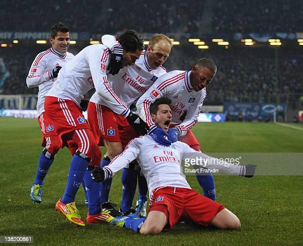 Jacopo Sala of Hamburg celebrates scoring his goal with Paolo Guerrero David Jarolim and Dennis Aogo during the Bundesliga match between Hamburger SV...