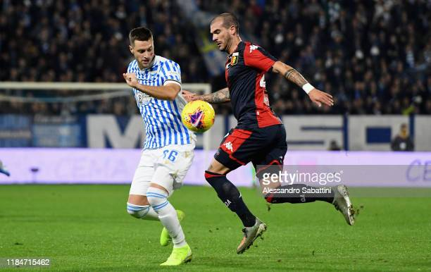 Jacopo Sala of SPAL competes for the ball with Stefano Sturaro of Genoa CFC during the Serie A match between SPAL and Genoa CFC at Stadio Paolo Mazza...