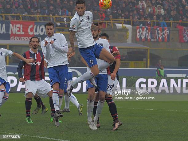 Jacopo Sala of UC Sampdoria gets the ball headed by Mattia Destro of Bologna FC with the hand commiting penalty foul during the Serie A match between...