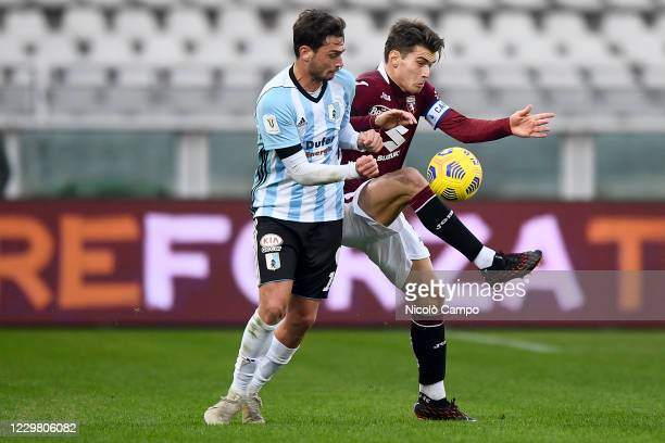 Jacopo Segre of Torino FC is challenged by Cassio Cardoselli of Virtus Entella during the Coppa Italia football match between Torino FC and Virtus...