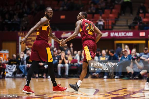 Jacorey Williams of the Canton Charge congratulates Jalen Jones of the Canton Charge on his 3pointer against the Greensboro Swarm on December 15 2018...
