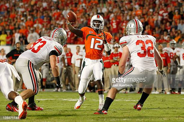 Jacory Harris throws the ball to Allen Hurns of the Miami Hurricanes for a touchdown against the Ohio State Buckeyes on September 17 2011 at Sun Life...