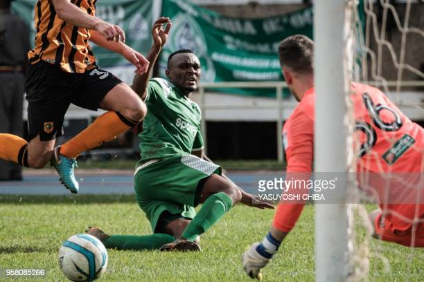 Jacque Tuyisenge of Kenyas Gor Mahia aims a goal against Goal Keeper Callum Burton of Englands Hull city during their friendly match at the Kasarani...