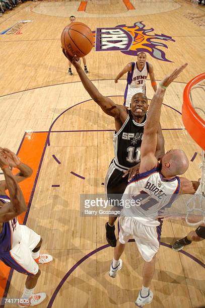 Jacque Vaughn of the San Antonio Spurs drives for a shot against Pat Burke of the Phoenix Suns in Game Five of the Western Conference Semifinals...
