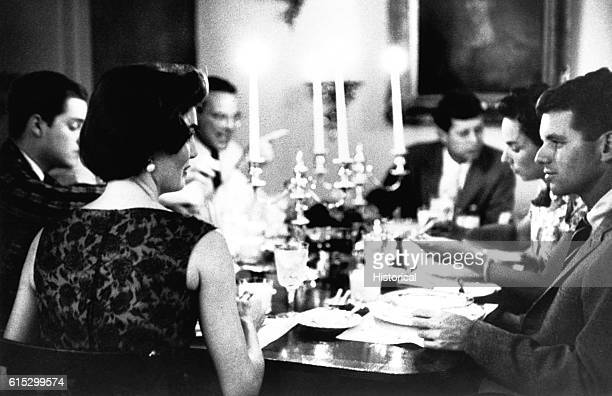 Jacqueline and Robert Kennedy at a dinner party hosted by the Kennedys in Georgetown June 3 1957