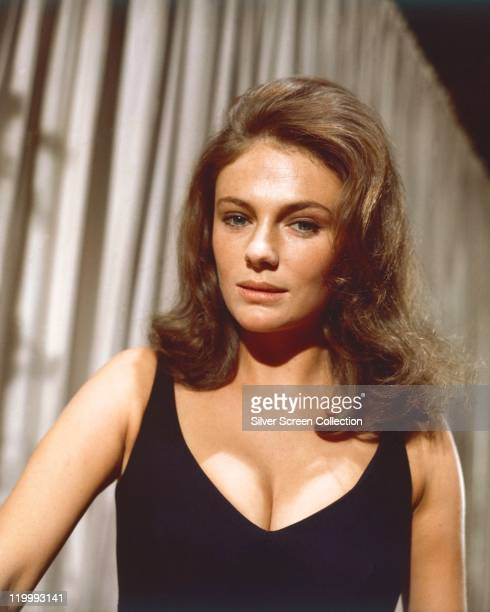 Jacqueline Bisset, British actress, wearing a black vest top in a studio portrait, circa 1970.