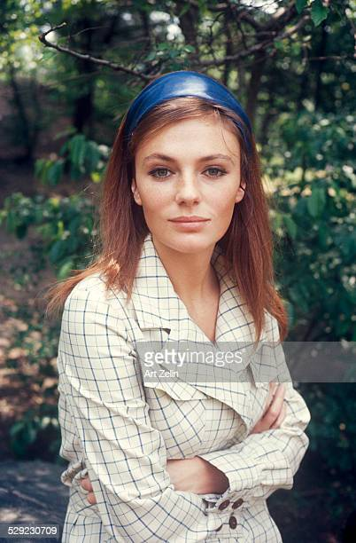 Jacqueline Bisset portrait in checked coat in park; circa 1970; New York.