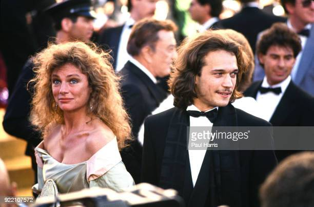 Jacqueline Bissett arrives with an escort March 29 1989 at the 61st Oscars Dorothy Chandler Pavilion Los Angeles California