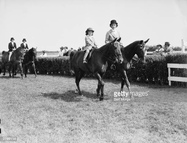 Jacqueline Bouvier and her mother Janet Lee Bouvier ride horses at the East Hampton Horse Show Long Island New York August 14 1937 Jeanne Murray and...