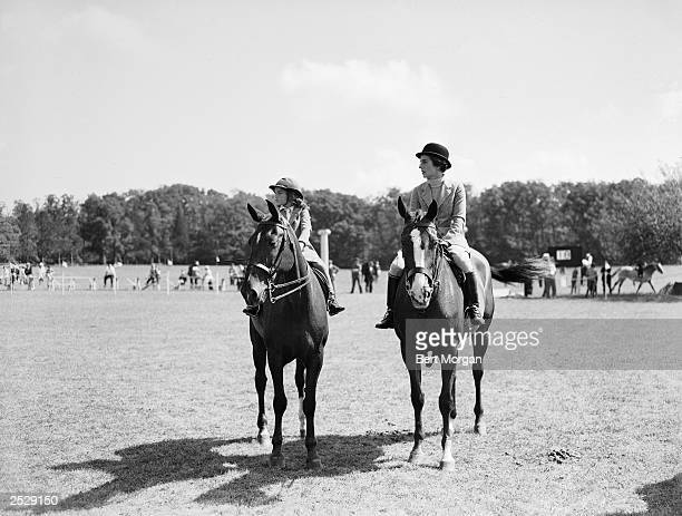 Jacqueline Bouvier and her mother Janet Norton Lee Bouvier ride horseback in the parentchild class of the Smithtown Horse Show Smithtown New York...