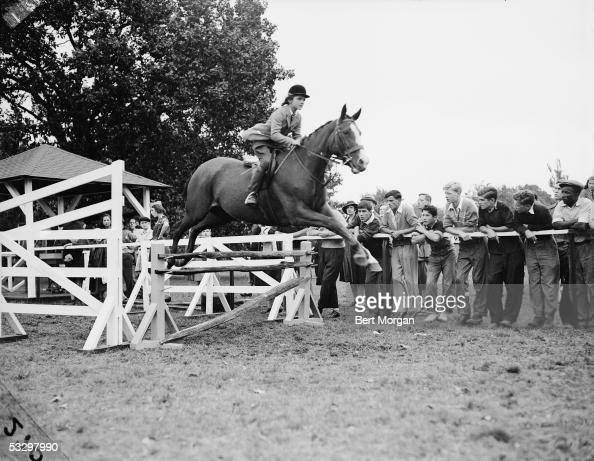 Jacqueline Bouvier Jumps Her Horse Danseuse Over A Fence