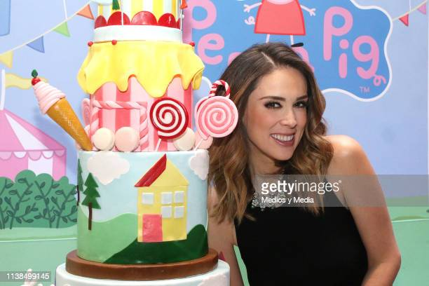 Jacqueline Bracamontes poses for photos with a Peppa Pig cake during the Press Conference of Discovery Kids TV Show 'Family Suite' at Hotel St. Regis...