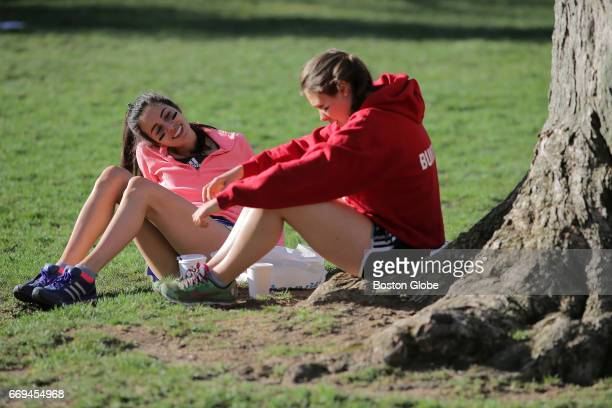 Jacqueline D'Attoma left and Amanda Monarchino of Ohio relax in the start village before the 121st running of the Boston Marathon in Hopkinton MA on...