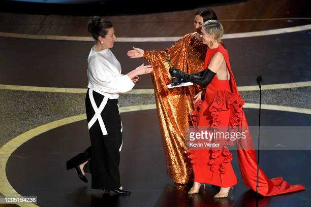 Jacqueline Durran accepts the Costume Design award for 'Little Women' from Maya Rudolph and Kristen Wiig onstage during the 92nd Annual Academy...