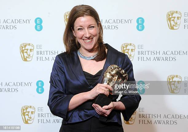 Jacqueline Durran winner of Best costume design poses in the press room at the EE British Academy Film Awards at The Royal Opera House on February 10...