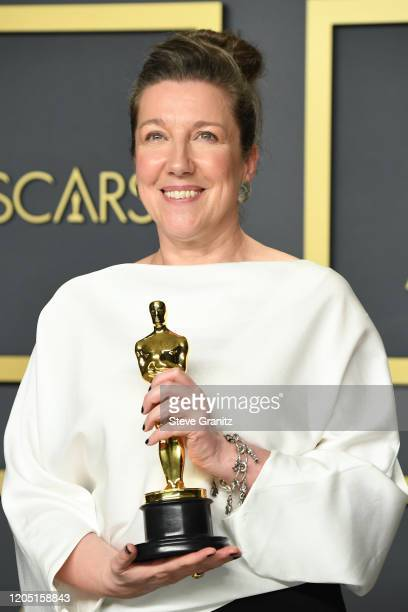 """Jacqueline Durran winner of the Costume Design award for """"Little Women """" poses in the press room during the 92nd Annual Academy Awards at Hollywood..."""