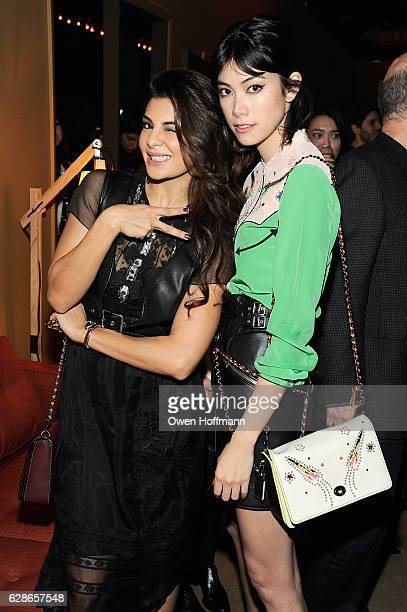 Jacqueline Fernandez and Hiraki Mori attend Coach 75th Anniversary Women's PreFall and Men's Fall Show on December 8 2016 in New York City