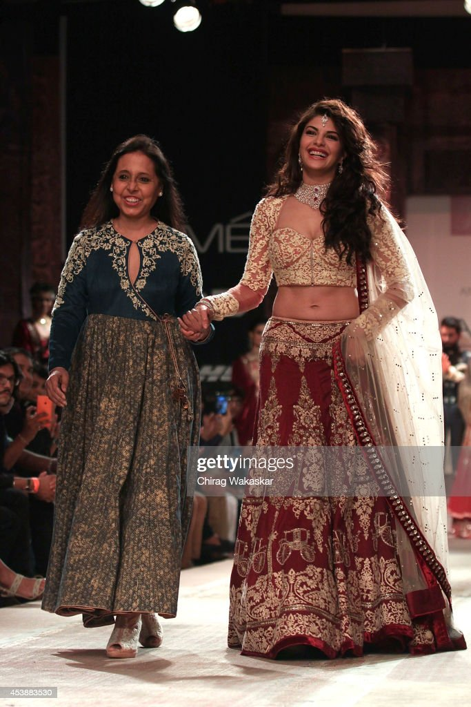 Jacqueline Fernandez walks the runway with Anju Modi during day 1 of Lakme Fashion Week Winter/Festive 2014 at The Palladium Hotel on August 20 2014..