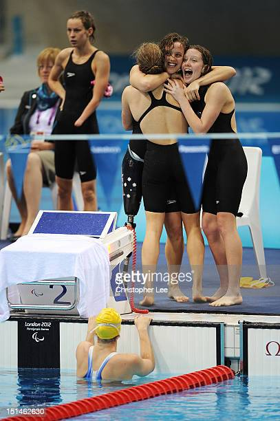 Jacqueline Freney Annabelle Williams Ellie Cole and Katherine Downie of Australia celebrate winning the gold in the Women's 4x100m Medley Relay 34...