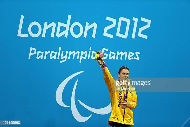 Jacqueline Freney of Australia posses with her Gold medal from the Women's 100m Freestyle S7 final on day five of the London 2012 Paralympic Games at...