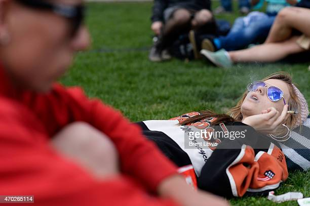 Jacqueline Gervasio blows out smoke on Saturday April 18 2015 at Civic Center Park in Denver Colorado The annual 420 Rally once again brought over a...