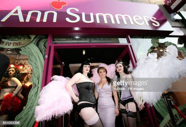 Jacqueline Gold the CEO of the company Ann Summers with models as she attends a party to celebrate the relaunch of the Ann Summers Oxford Street...