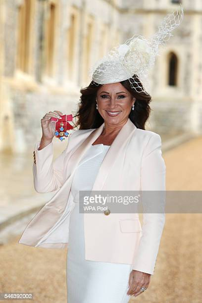 Jacqueline Gold the chief executive of Ann Summers poses after receiving her Commander of the Order of the British Empire medal by Princess Royal at...