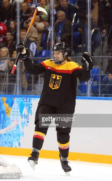 Jacqueline Janzen of Germany celebrates her goal against Nana Fujimoto of Japan in the first period during the Women's Classifications Game on day 11...