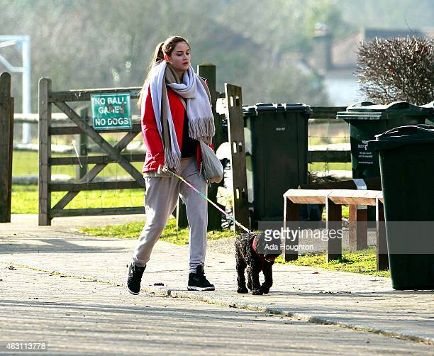 Jacqueline Jossa is pictured walking the dog on February 9 2015 in London England Jacqueline had just been for a power walk maybe to encourage the...