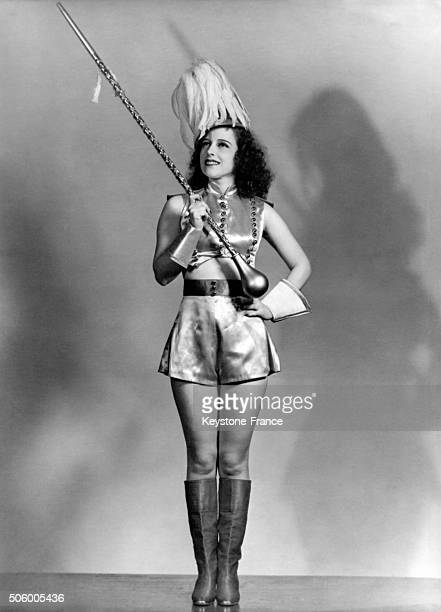 Jacqueline Joyce the technicolor girl in her dance of a thousand Lights posing as she was conducting her own orchestra dressed as a majorette in...